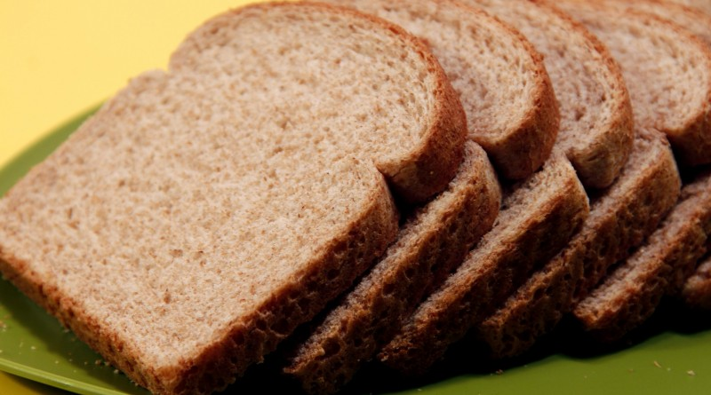 several-slices-of-whole-wheat-bread-that-had-been-set-atop-a-green-plate